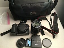 Canon EOS 70D 20.2 MP Digital SLR Camera w/ 18-135mm STM Lens + Extras