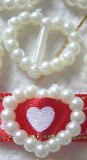 5 boucles en perle couleur ivoire en forme de coeur