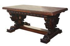 Table en chêne sculpté de style Renaissance à décor de griffons