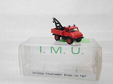 eso-291IMU 1:160 Unimog Feuerwehr Kranwagen Metallguß sehr guter Zustand