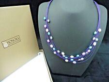 Horona Necklace. Multi string Floating Pearl. Purple tones.