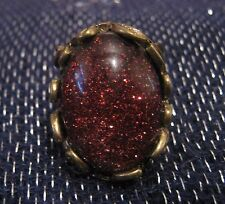 Wonderful bronze tone metal ring with large feature speckled oval bead size M