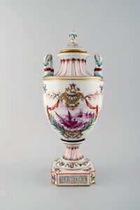Antique lidded vase of porcelain in overglaze. Classic style. late 1800s