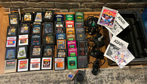 Atari 2600 Game Lot; Joystick, Paddles And More Vintage 1980s Games Huge Over 50