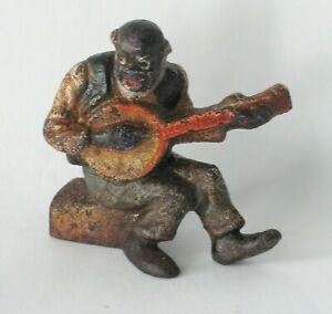 Antique cast iron black man playing a banjo paper weight Hubley folk art rustic.