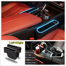 Universal 2Pcs 4 puertos USB Caja de almacenamiento de relleno brecha de asiento de coche luz LED azul alrededor de