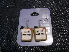 Fabulous silver tone metal fun earrings with moustached face and hat