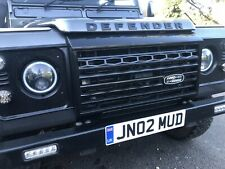 Defender Adventure Grill Badge