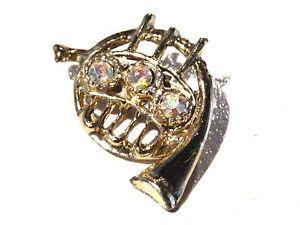 Bijou alliage doré broche thème musique piston cristal brooch