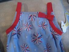 First Moments Celebration Fireworks one piece with ruffled leg openings Nb