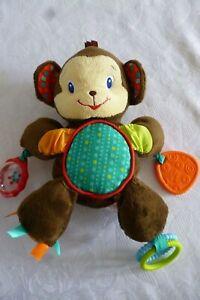 Bright Starts Baby Motorik-Spielzeug Affe mit Rassel / Knisterohren ca. 24 cm