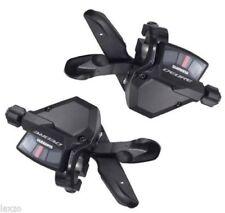 Mandos de cambio negro Shimano para bicicletas con 9 velocidades