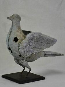 Antique French weather vane pigeon mounted on iron block