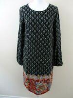 "Nomads tunic dress size M/12 black small floral 9"" floral large floral hem"