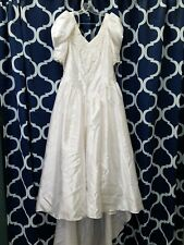 Plus size wedding dress, full length with train. Size 18 but has been taken in.