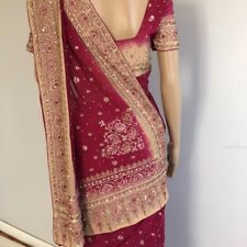 saree with readymade blouse. Antique gold Zari with ruby and diamond stones.