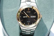 NEW CITIZEN ECO DRIVE WRISTWATCH E100 WATCH BLACK FACE WR100 GOLD TRIM STAINLESS