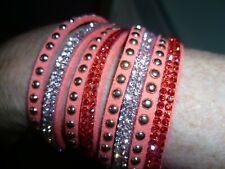 Two Bracelets  Oe Orange and One Purple