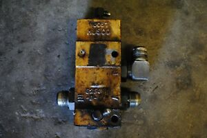 UNLOAD HYDRAULIC VALVE E2NNB889AB29Z | Ford 555B Backhoe