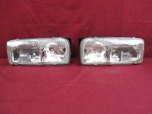 NOS OEM Oldsmobile 88 Headlight Headlamp 1994 - 95 PAIR 1994 - 1996 98 Regency