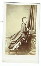 Victorian cdv photo young lady kneeling on chair unstated photographer