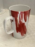 2014 Starbucks Mug, Tall White Background With Red Paint Strips And Gold Letters