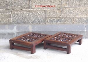 A PAIR OF QING DYNASTY HUANGHUALI FOOTSTOOLS