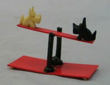Celluloid Dogs on Teeter-Toter