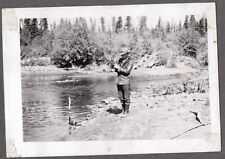 Vintage Cordova Alaska Building Road Eyak Hwy. Worker Fishing With Stick Photo