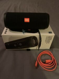 JBL Flip 4 Bluetooth Waterproof Speaker in box with charger