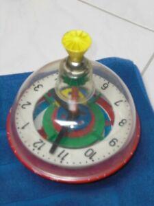 bunter Kinder Brummkreisel mit Uhr und Uhrwerk