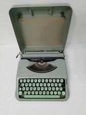 1960's Hermes Rocket typewriter in case light green finish very clean