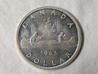 1963 $1 QUEEN ELIZABETH II .800 SILVER CANADIAN CANOE DOLLAR  AU COIN IN CAPSULE