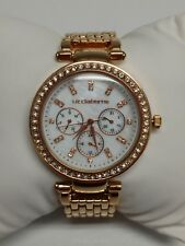 B037 Jcpennys Liz Claiborne Watch rose gold tone rhinestone accents day month
