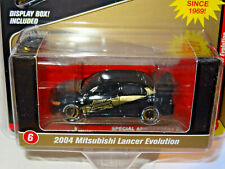 JOHNNY LIGHTNING MIJO EXCLUSIVES BLACK & GOLD 2004 MITSUBISHI LANCER EVOLUTION