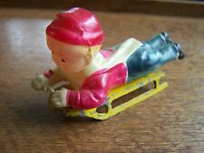 CELLULOID BOY ON METAL SLED-OCCUPIED JAPAN-
