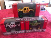 SET OF 3 MODERN CITY DIECAST MONSTER TRUCKS VEHICLES CARS NEW BOXED