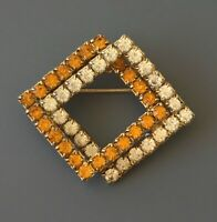 Vintage prong set double square brooch in gold tone metal with Crystals.