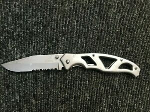 Gerber stainless blade folding knife. semi serrated and Gerber embossed