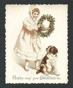 Y17 - GIRL IN WHITE WITH HOLLY WREATH AND DOG - GLITTERED VICTORIAN XMAS CARD