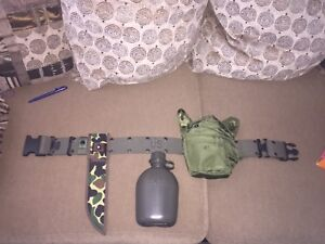 US ARMY MILITARY BELT WITH CANTEEN AND KNIFE HOLDER COMPLETE W/ONE QUART BOTTLE