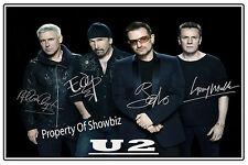 U2 - BONO, THE EDGE, ADAM CLAYTON & LARRY MULLEN JR. AUTOGRAPHED PHOTO