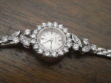 montre de femme années 50 OMEGA en or 18 carats et diamants