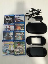 Sony Ps Vita SLIM nera, fornita di cover, custodia più otto giochi.