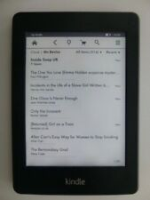 Amazon Kindle Paperwhite 2GB, Wi-Fi, 6 inch. Case & charger bundle & 514 books.