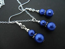 A  BLUE GLASS PEARL   NECKLACE AND EARRING SET. NEW.