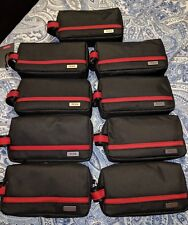 New With Tags   TUMI Cord Pouch  Black/Red Rectangular Shape.