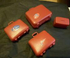 a vintage collection of Barbie / Sindy clone suitcases made in USA