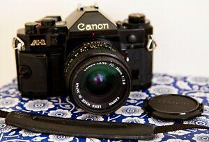 Canon A-1 35mm SLR Film Camera - Black 28/. 2.8 FD LENS