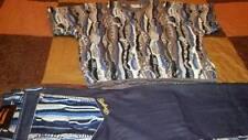 COOGI Sweater & Matching Denim pants ensemble $300 LessThanRetailStores